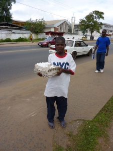 Liberian Boy Selling Eggs